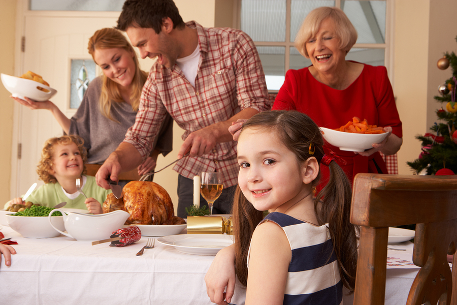 bigstock-family-serving-christmas-dinne-27387584