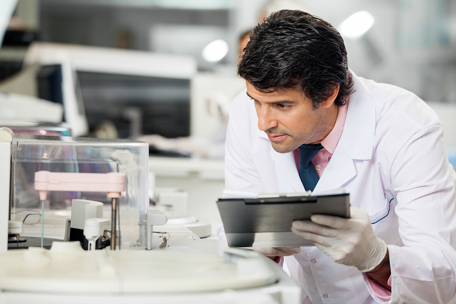 bigstock-male-scientist-observing-exper-58750010
